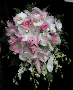 Cascading bouquet featuring pale pink oriental lilies, white phaelonopsis orchids, white Singapore orchids, Rosita Vendella roses and leather fern. Wedding Bouquets Pictures, Oriental Lily, Cascade Bouquet, Pale Pink, Pretty In Pink, Orchids, Beautiful Flowers, Floral Wreath, Wreaths