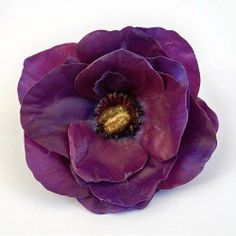 "Anemone Artificial Flower Pin Brooch, Purple by Yves Decor. $6.90. Height: 1.5"". Diameter: 4.5"". Color: Purple. Flower: Anemone. Closure: Round Metal Pin. This beautiful pin brooch, is handmade with high quality materials, leaving you with a silk flower that blooms far beyond the cheaper alternatives."