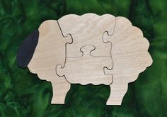 """This Sheep Puzzle is fun to do and assist in the development of small motor, hand-eye coordination, visualization and problem solving skills all of which are important in the process of reading. Our puzzles are made from toy quality 1/2"""" Baltic birch plywood and are rubbed with AMF Naturals, an oil wax finish that is completely safe. Any paint or stain used on our puzzles is non-toxic and water based. Dimensions: 4.75"""" high, 7.5"""" long"""
