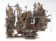 Alfred Corrine Marie - ACM - builds architectural forms from small parts of old typewriters, clocks & electronic parts
