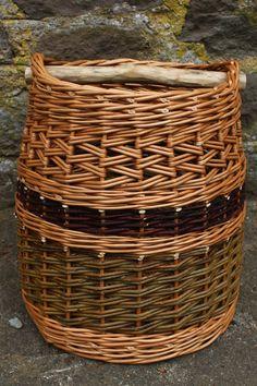 Circular basket with walnut handle. Rachel Bower.