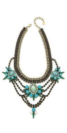 Swarovski crystals trap glittering stone clusters on a DANNIJO necklace