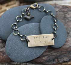 When life pushes me beyond what I know...When the fear tries to settle in...Sometimes I step outside, feel the warm sun upon my shoulders, look up at the blue sky, and decide it is time: so i fly :: a hand stamped soul mantra bracelet