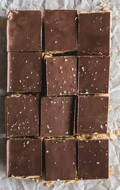 You ll love this No-Cook Peanut Butter and Chocolate Oat Squares recipe It s ready in minutes vegan with only 4 ingredients no-cook peanut butter chocolate slice Chocolate Slice, Chocolate Oats, Homemade Chocolate, Chocolate Butter, Chocolate Peanut Butter Squares, Chocolate Squares, Chocolate Sweets, Homemade Dog, Chocolate Recipes