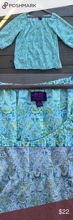 J Crew Liberty prints top Very pretty cotton top from J Crew. Peasant shape with elastic at arms and very loosely at waist. Made with Liberty Art prints fabric. Photographed outside in natural light with no filters but be aware colors differs with camera used and screen viewed on. Great condition size XL J. Crew Tops Blouses