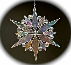 stained glass snowflake suncatcher  (design 10). $30.00, via Etsy.