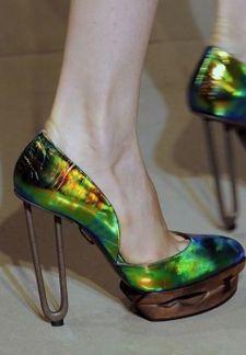Another series of raw seams sealed a second superlative for Milan Fashion Week. Jil Sander, Vogue, Beetlejuice, Stiletto Heels, Prada, Peep Toe, Pumps, Shoes, Fashion