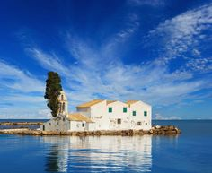 Panagia Vlachernon - a small monastery located on Pontikonisi, Corfu, in one of the most photographed landscapes of the island. https://greece.terrabook.com/corfu/page/panagia-vlaherna #Greece #Corfu #terrabook #GreekIslands #TravelTips #Travel #GreeceTravel #GreekPhotos #Traveling #Travelling #Holiday #Summer