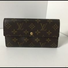 100%Authentic Louis Vuitton Monogram Long wallet 100% Authentic Louis Vuitton Monogram Long wallet Sarah Old Version. Pre-Owned used in very good condition. No smell, Corner area has some sign of usage. MADE IN FRANCE DATE CODE CT0083 ( August 2003 )  Please check all the pictures. -In order to avoid unnecessary return - No return sold as is- Louis Vuitton Bags Wallets