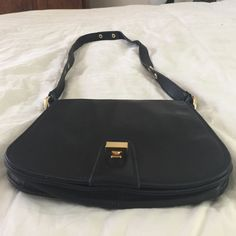 Badgley Mischka all black leather cross body bag Beautiful black leather Badgley Mischka cross body bag with exchangeable straps if you like it shorter! It ha three slots on the inside and also a zippered pocket as well. Beautiful bag! Badgley Mischka Bags Crossbody Bags