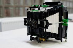 If you really want to get experimental with photography, you could always try what photographer Dominique Vankan did and build yourself a custom large format camera. What were his building blocks of choice? His somewhat questionable choices were LEGO, cardboard, and duct tape.