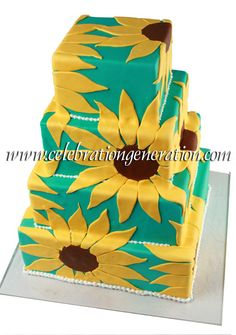 Love the contrast of the yellow sunflowers against the turquoise background!
