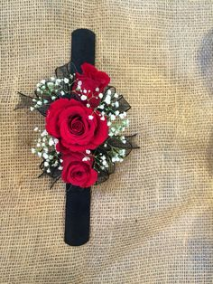 37 Red rose and babies breath with black ribbon corsage