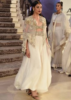 Model walks the ramp in off white outfit with gold embroidery for Anamika Khanna's Sculpt collection at Lakme Fashion Week Summer Resort 2015