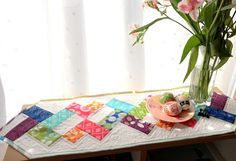 It's my turn on the Sew Lux Fabrics Charm Madness blog hop and I'll be sharing a tutorial to make this quick and easy table runner – perfect for a small table or dresser! I even tried out the Threadbias Quilt Design Tool to make the illustrations… not perfect, but we will get there! I …