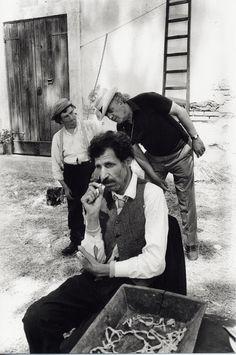 Nando Orfei and Federico Fellini on the set of Amarcord, 1973