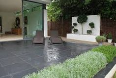 Midnight black limestone - It can be laid in uniform sizes but looks equally as good in a random pattern. The black colour can also be enhanced by using a sealant Block Paving Patio, Slate Paving, Patio Slabs, Patio Tiles, Garden Paving, Paving Stones, Limestone Pavers, Paving Ideas, Contemporary Garden Design