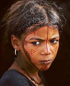 Africa | Tuareg girl painted as a protection against jinns (demons) | ©unknown