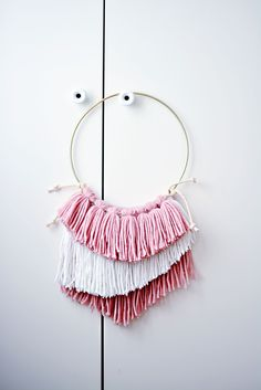I'm teaching my little girl how to make these easy DIY yarn dream catchers from MichaelsMakers Little Inspiration