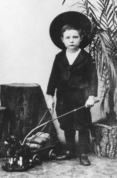 Paul Hindemith at an early age playing with a toy carriage.