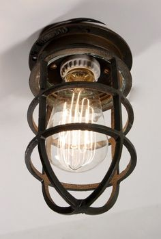 caged industrial lights $25