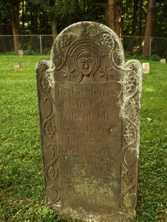 Interesting old headstone (c. 1806). Very stylized face. Lettering carries to next line.
