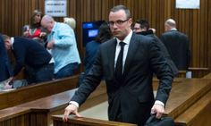 Oscar Pistorius leaves the dock during his murder trial at the high court in Pretoria.