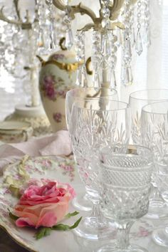 floral china, crystal, and a dainty pink rose