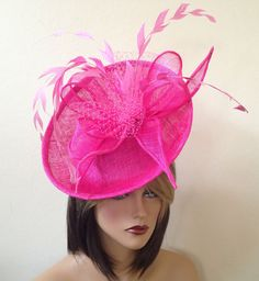 This beautiful pink fasciantor is made of sinamay fabric and adorned with sinamay loops, russian veil and feathers.Its mounted on a 6 fascinator base and a headband for a comfortable wear. It looks absolutely beautiful!!! It will be perfect for the opening day for Kentucky Derby, Del Mar races, wedding, cocktail party or a tea party.  It can be made in any color combination you desire. Please discuss with me the color of your choice and Ill try to make it happen for you.  For any custom…