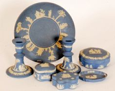 A pair of Wedgwood pale blue classical candlesticks 13cm high, a circular plate, a powder box and cover a pin dish and two similar boxes and covers
