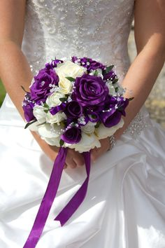 Purple and white bridal bouquet Bridesmaids with deep purple bouquets