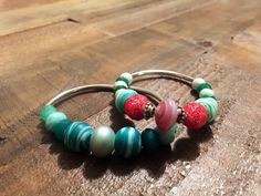 A personal favorite from my Etsy shop https://www.etsy.com/listing/232887576/spring-silver-pink-and-green-bracelet