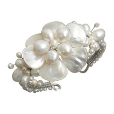 @Overstock - Add a touch of elegance to your jewelry collection with this stunning pearl bracelet. Handmade by Thai artisan Lai, this cuff bracelet features strands of freshwater pearls and a large mother-of-pearl flower that is sure to be noticed.http://www.overstock.com/Worldstock-Fair-Trade/White-Shell-Flower-and-Beaded-Pearl-Bracelet-7-20-mm-Thailand/5601229/product.html?CID=214117