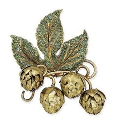 A DEMANTOID GARNET AND GOLD 'BRANCHE DE HOUBLON' BROOCH, BY RENÉ BOIVIN | Jewelry Auction | flowers & plants, Jewelry | Christie's