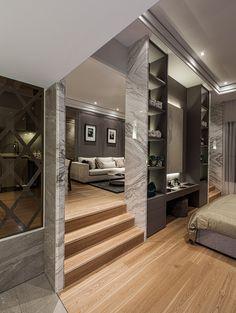 Modern glamorous space. Walls. Nooks. Bookshelves. Organized living space. Step up sitting area