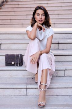 Spring / Summer - street chic style - business casual style - office wear - work outfit - party style - pale pink culottes + white relaxed fit sleeveless turtleneck sweater + snake print ankle strap heeled sandals + dark grey suede clutch