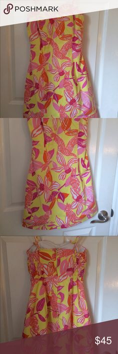 Lilly Pulitzer Sundress This dress is a size four, beautiful print Lilly Pulitzer dress. It is a bit short, so best for a petite girl! Lilly Pulitzer Dresses