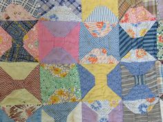 """Yes, this is another one from Mama's collection, probably from the 1920s. Quilt squares are 4""""! Quilt measures 80"""" x 64"""". Imagine my surprise when I discovered the back is made from what appears to befour 100 pound feed sacks. I included some photos of the logos. If you have an """"invert"""" function on a photo program, youshould be able to readthem. It has some minor stains, but overall in great condition considering the age. See photos for detail and condition."""