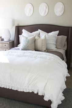 Alice Lane Home: Beautiful bedroom design with light gray walls, Porcelain Cockatoo Wall Plaque, ...