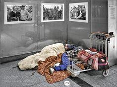 Homeless men in a subway station by HerbertAFranke