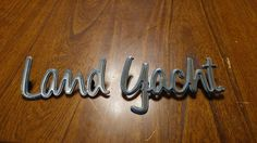 very cool vintage Land Yacht emblem time to make a few of these...shiny