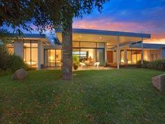 Pavers modern house exterior with bi-fold windows & decorative lighting