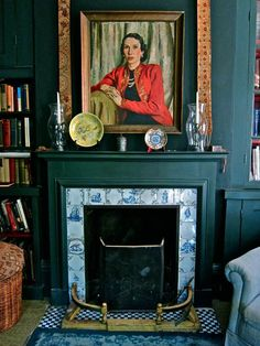 Bold paint and vintage blue porcelain tiles for the fireplace in Jocasta Innes's House in Spitalfields, London. Fireplace Tile Surround, Paint Fireplace, Fireplace Inserts, Fireplace Surrounds, Painted Fire Surround, Above Fireplace Ideas, Fireplace Mantles, Stone Fireplaces, Bedroom Fireplace