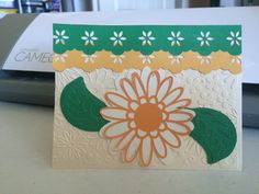 Silhouette  Cameo flower and borders on a dry embossed card base