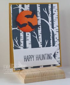 handmade Halloween card from Debbie's Designs ... die cut bats on a moon ... birches embossing folder with black ink background ... Stampin' Up!