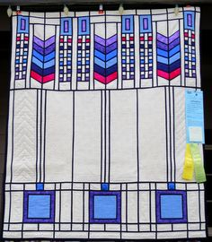 """Window of Mystery, 42 x 50"""", stained glass quilt by Pat Busby of Lake Oswego OR.  2015 Sisters Outdoor Quilt Show.  Photo by First Light Designs"""