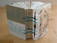 Cassette tape book. I've made one of these before but with tapes for both the front and back cover and old telephone wire as the thread to sew everything together. I like this idea better, I think...