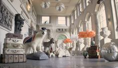 The grand ballroom in Aynhoe Park is filled with James Perkins works of art and taxidermy including a polar bear in flying goggles and a rocking horse zebra worth £24,400