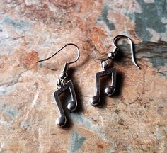 Musical Note Pair Of Silver Dangle Earrings, Handmade Earrings, Fish Hook Earrings, Ideal Gift for The Music Lover you Know, Great Birthday Gifts, Special Occasion Gifts, Ladies Earrings, Women's Jewelry.  All Items Can be personalized.  Gift Wrapping is also Available Just contact me when you order.  Thank you for your time | Shop this product here: http://spreesy.com/SpryHandcrafted/222 | Shop all of our products at http://spreesy.com/SpryHandcrafted    | Pinterest selling powered by…