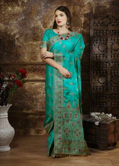 Fancy Teal Color Silk Full Embroidered Stone Work Party Wear Saree Product Details : Let your little women flaunt her fashionable side with this teal color saree. Crafted of silk fabric, this designer saree comes with unstitched silk blouse piece. Wedding Sarees Online, Saree Wedding, Bridal Sarees, Traditional Silk Saree, Lehenga Saree, Sari, Latest Designer Sarees, Art Silk Sarees, Indian Ethnic Wear